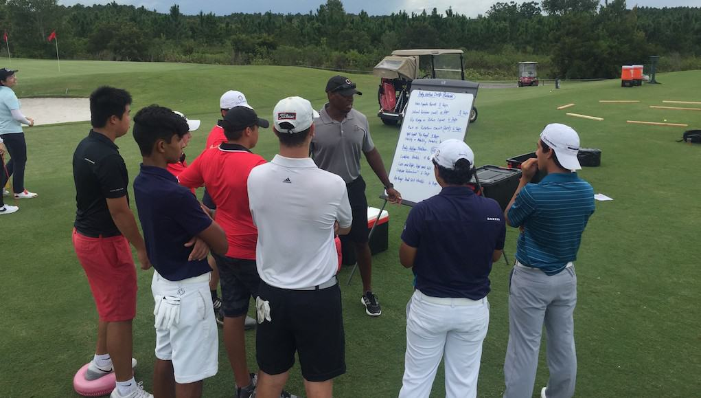 Coach correcting mental tips for golfers