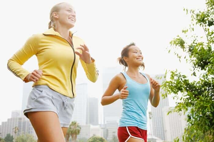 young women running in the park